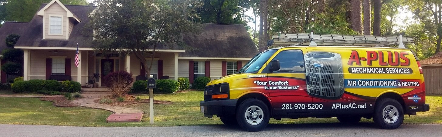 A-Plus Mechanical work van in front of a house.