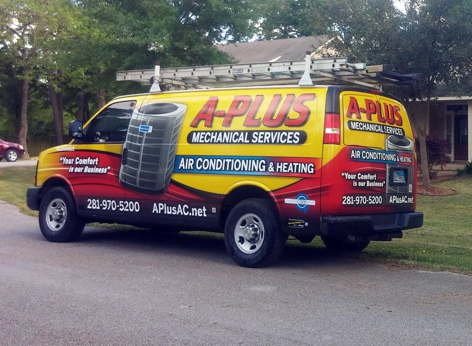 A-Plus Mechanical work van parked on the street.